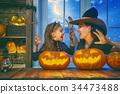 family celebrating Halloween 34473488