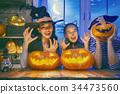 family celebrating Halloween 34473560