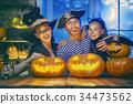 family celebrating Halloween 34473562