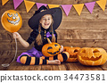 little witch with a pumpkin 34473581