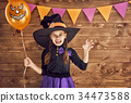 little witch with a pumpkin 34473588