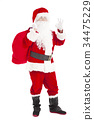 Santa Claus holding gift bag with ok gesture 34475229