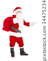 Santa Claus holding gift bag and showing 34475234