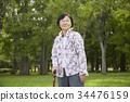 간호 지팡이를 점화 여성의 초상화 34476159