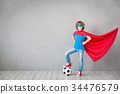 Child pretend to be soccer superhero 34476579