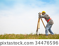 Surveyor engineer making measure on the field 34476596
