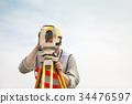 Surveyor engineer making measure  34476597