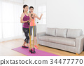 healthy slim girl student using resistance band 34477770