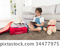 little kid finished packing luggage suitcase 34477975