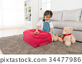 beauty girl children sitting on living room floor 34477986