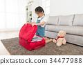 sweet pretty female children kneeling on floor 34477988