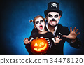 family father and daughter in costumes and make-up to Halloween 34478120
