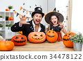 happy family father and child daughter in costumes   for hallowe 34478122