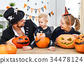 happy family mother father and child son in costumes and makeup 34478124