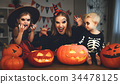 family mother and children in costumes and makeup to halloween w 34478125