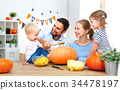 happy family mother father and children cut pumpkin for   hallow 34478197