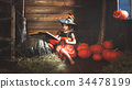 Halloween.  little  witch   conjures with  book of spells,  magi 34478199