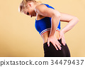 Fit woman suffering from back pain 34479437