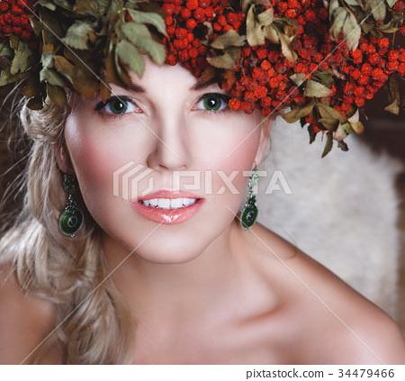 Beautiful girl with rowan wreath on her head 34479466