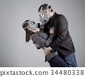 Couple in gas masks 34480338