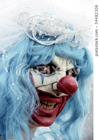 scary evil clown in a bride dress 34482306