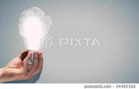 Light bulb with cogwheels 34485368