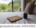 bed, lens, notebook 34503965