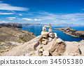 Stone cairn with scenic dramatic landscape 34505380