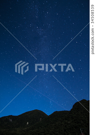 Starry sky and shooting star and mountain 34508539