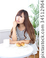 Young woman in cafe 34512964