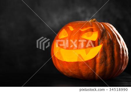 Three halloween Jack O' Lantern pumpkins 34518990