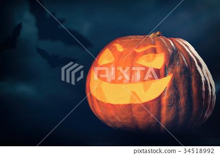 Three halloween Jack O' Lantern pumpkins 34518992