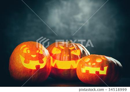 Three halloween Jack O' Lantern pumpkins 34518999