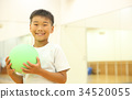 Children playing with ball 34520055