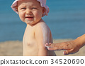 Baby sunscreen cream. 34520690
