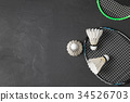 Shuttlecocks and badminton racket on black  34526703