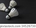 White shuttlecocks on black background. 34526730