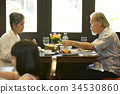 a senior couple is having lunch together at a restaurant. 34530860