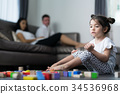 Baby cry and sit in living room with her mom and mother 34536968