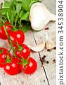 fresh tomatoes, rucola, garlic and peppercorns 34538904