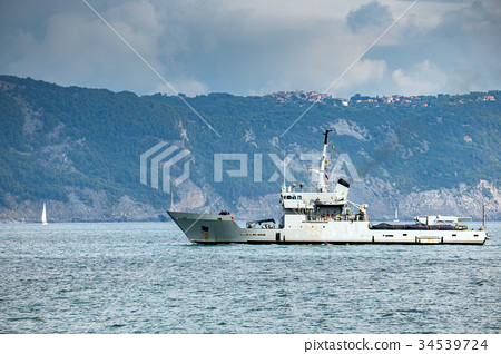 destroyer war ship in action for migrants boat 34539724