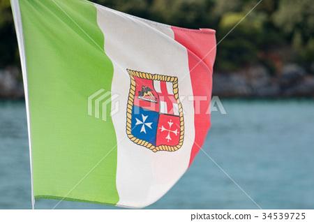 italian marine flag weaving on the sea 34539725