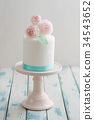 Mini wedding cake with flowers 34543652