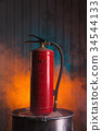 Red fire extinguisher on urban style background 34544133