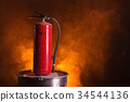 Fire extinguisher on orange smoky background 34544136