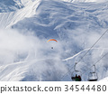 Chair-lift and paraplane on ski resort  34544480