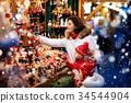 Family shopping Christmas presents at xmas fair 34544904