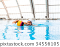 Water polo player in a swimming pool. 34556105