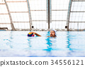 Water polo player in a swimming pool. 34556121