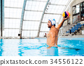 Water polo player in a swimming pool. 34556122
